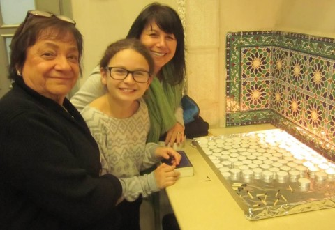 My mom, Maddy and I light the Shabbat candles in Jerusalem