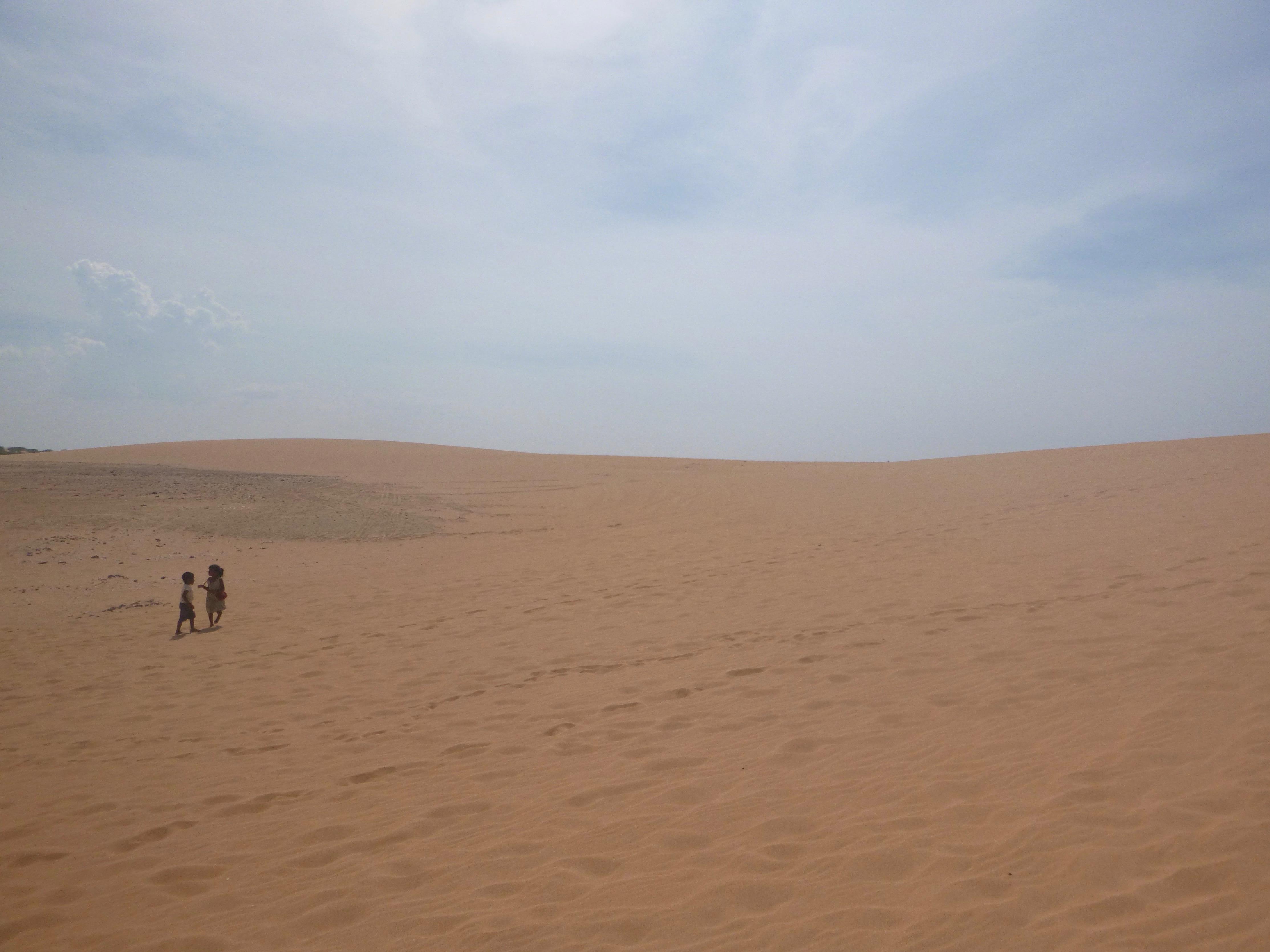Wayuu children explore the Dunes of Taroa