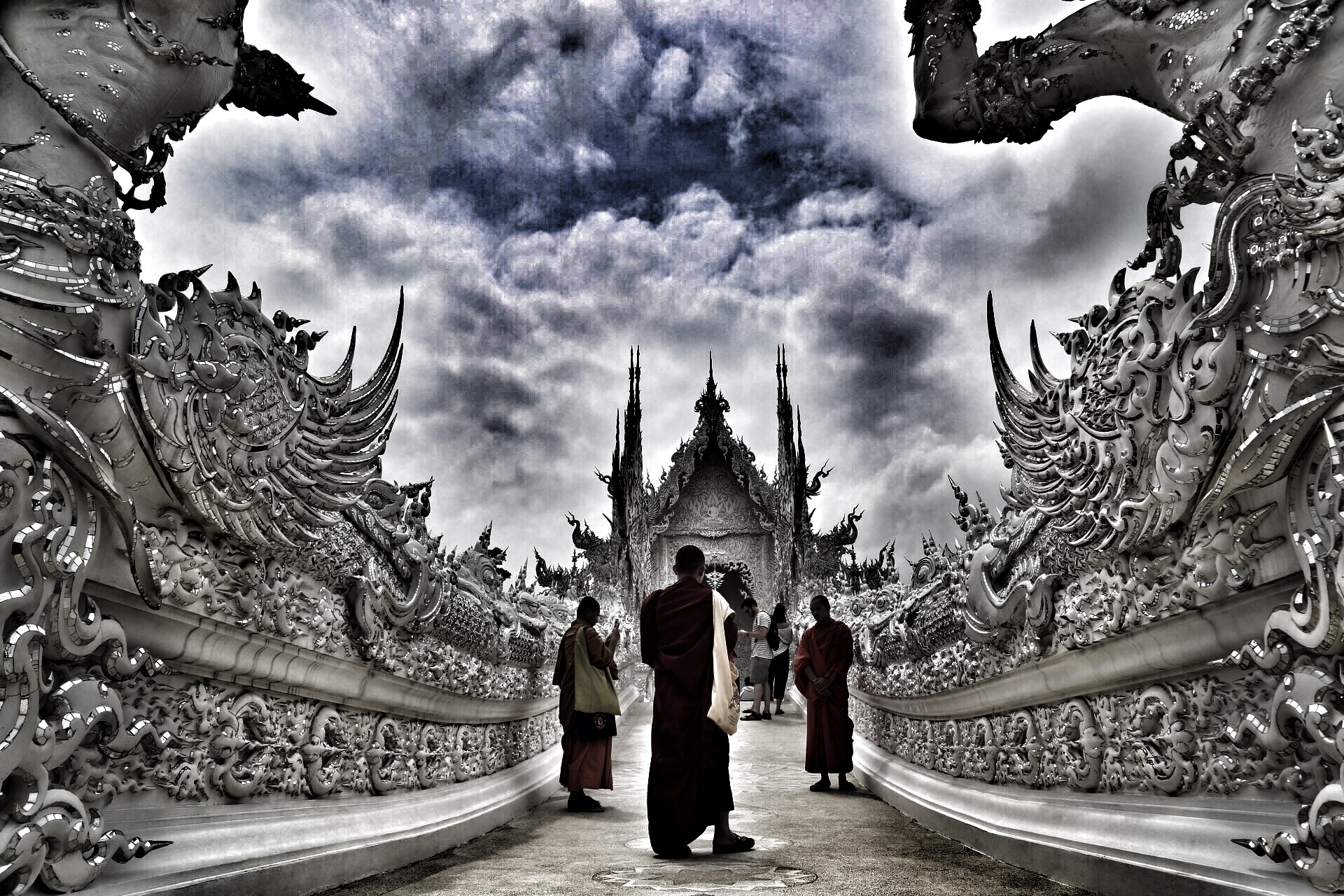 Monks paying their respect at the White Temple in Chiang Rai, Thailand