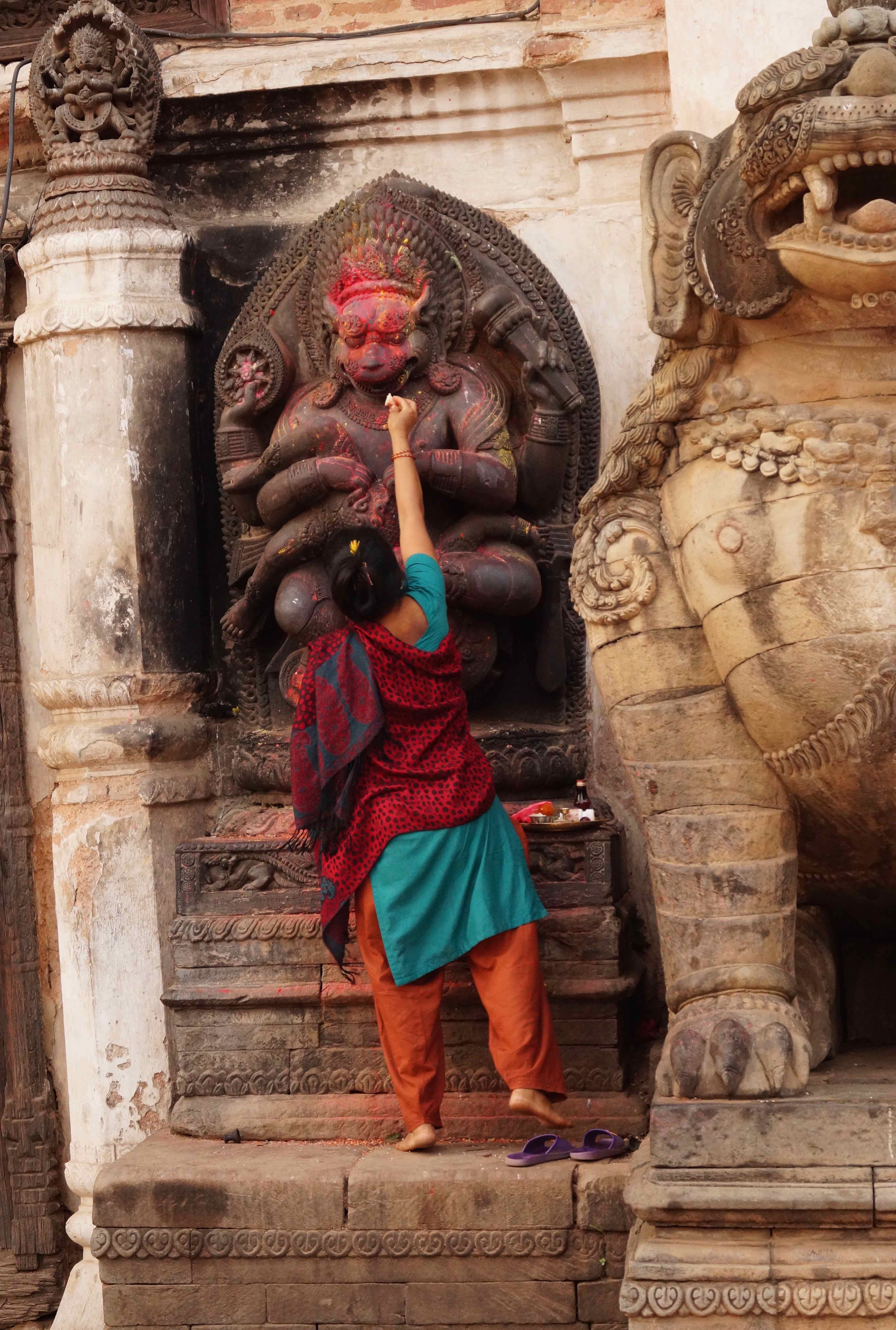 Offering to the Monkey God Hanuman on Durbar Square, Kathmandu Nepal