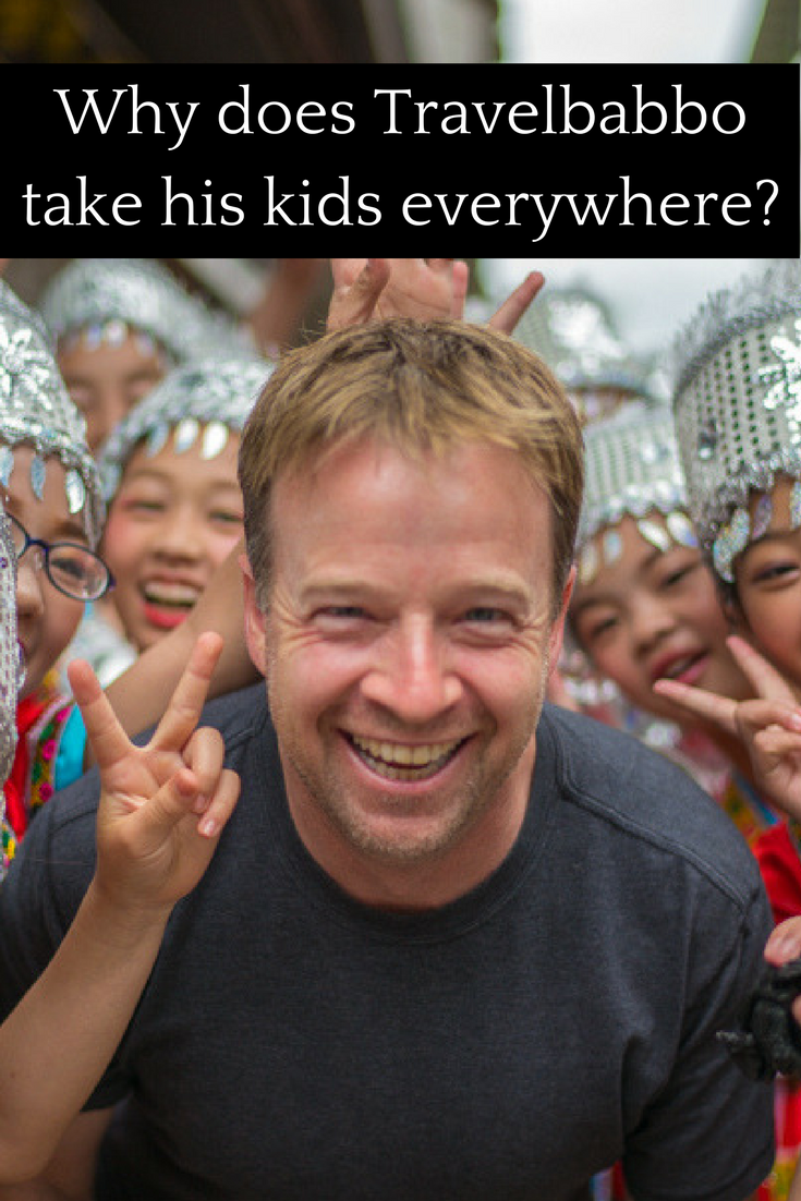 Why does Travelbabbo takes his kids everywhere?