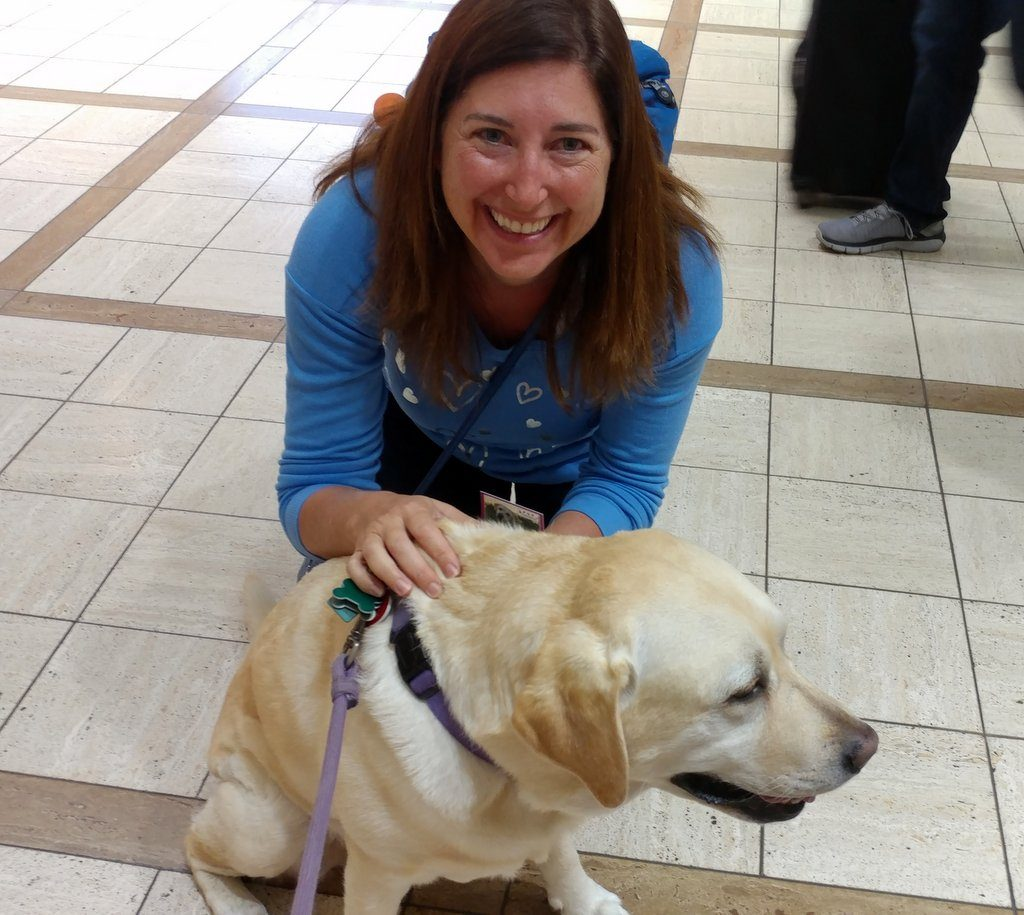 Lisa Niver with one of the LAX PUPS Therapy dogs